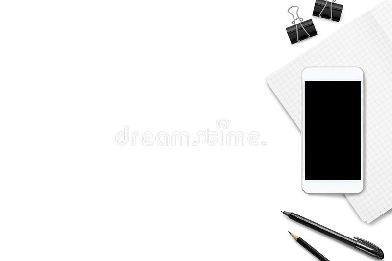 White office desk table with smartphone, notebook and supplies. Top view with copy space, flat lay stock images