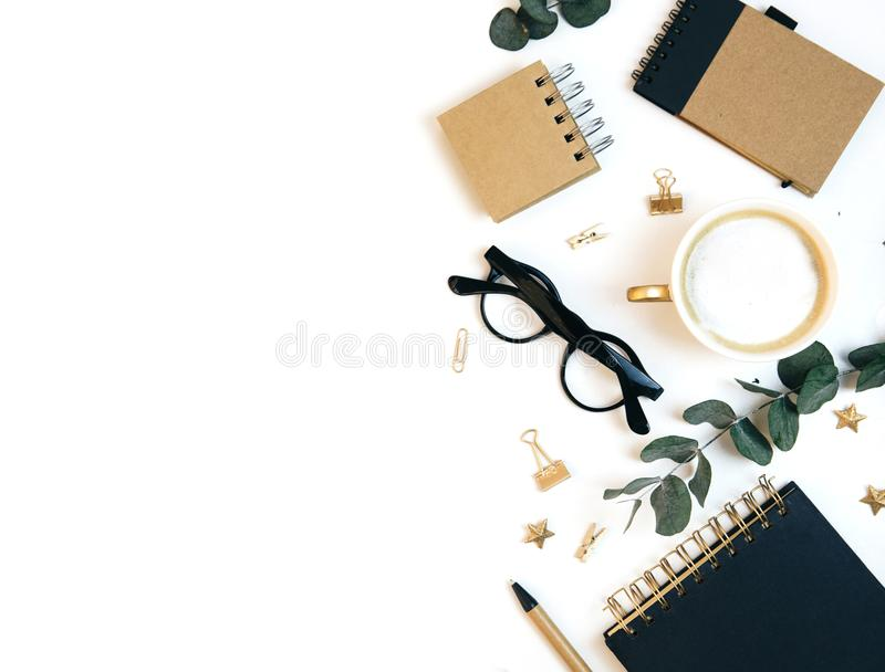 White office desk workspace with coffee, paper blank, green leaves and office supplies. royalty free stock images