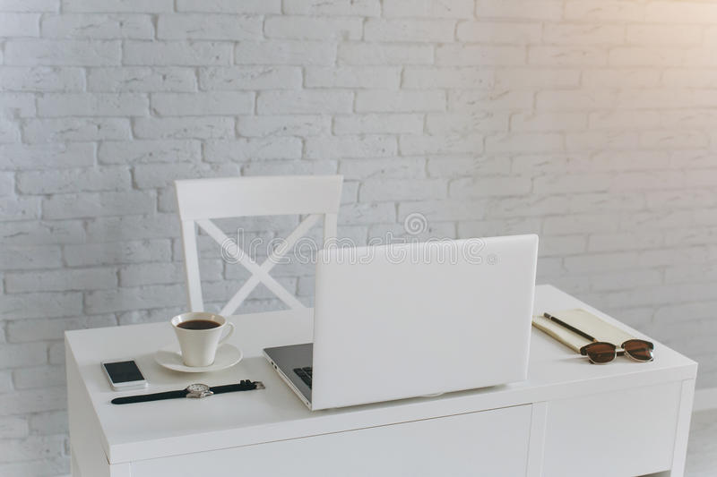 White Office desktop. White desk businessman. is on the table glasses, coffee, office and computer stock photos