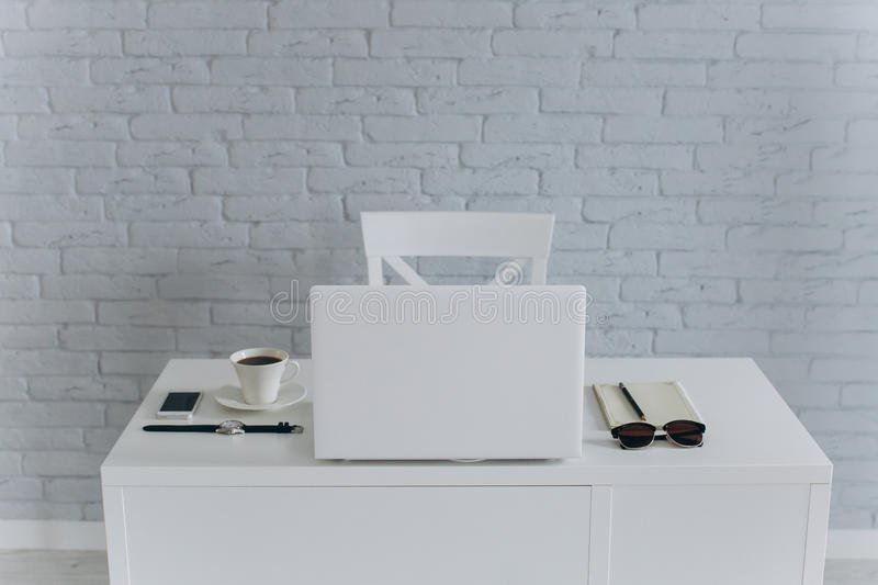 White Office desktop. White desk businessman. is on the table glasses, coffee, office and computer stock image