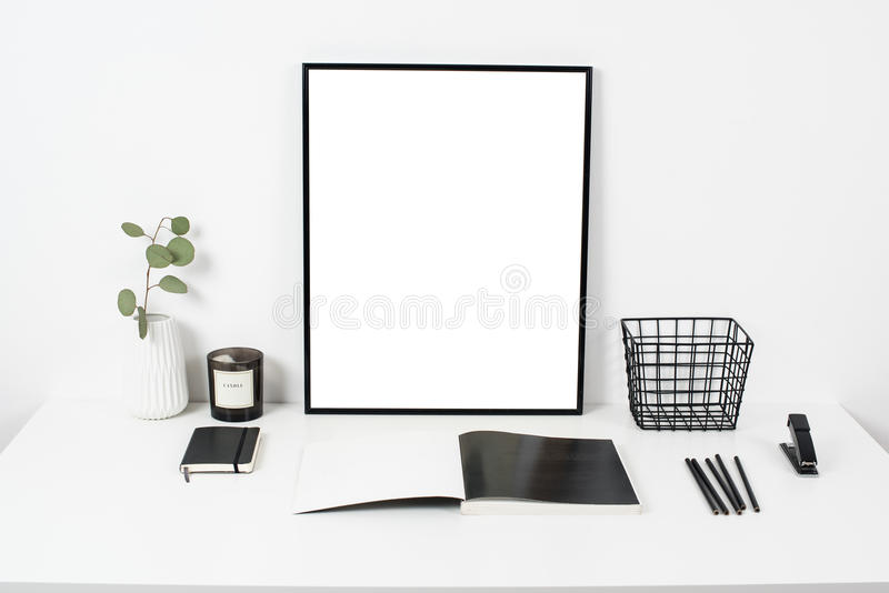 white office interior, stylish work table space with poster artw stock photos