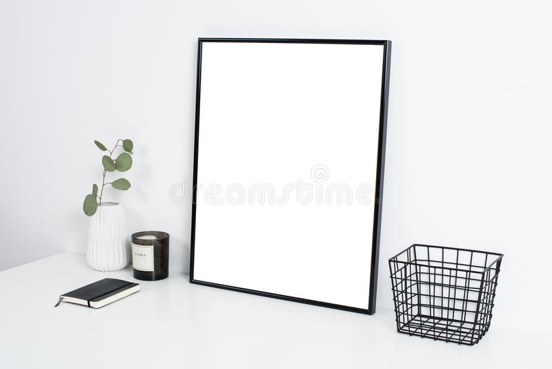 White office interior, stylish work table space with poster artw. Minimalist white office interior, stylish work table space with poster artwork mockup royalty free stock photography