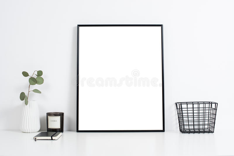 White office interior, stylish work table space with poster artw. Minimalist white office interior, stylish work table space with poster artwork mockup stock photos