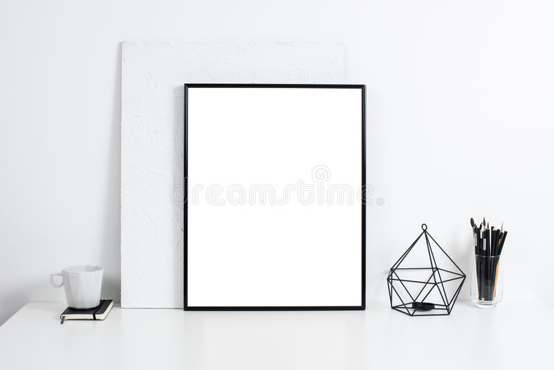 White office interior, stylish work table space with poster artw. Minimalist white office interior, stylish work table space with poster artwork mockup stock images