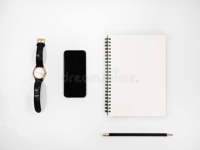 White office table with a lot of things. stock photo