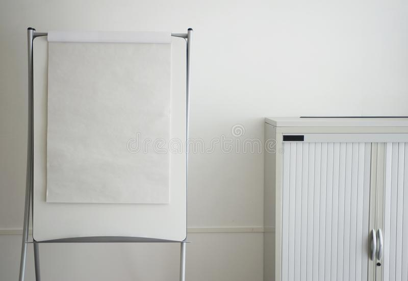 White office with a white flip chart royalty free stock photography