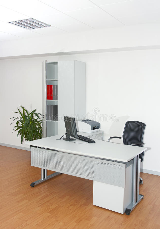 White office on wood floor. White office workspace for bussines stock photo