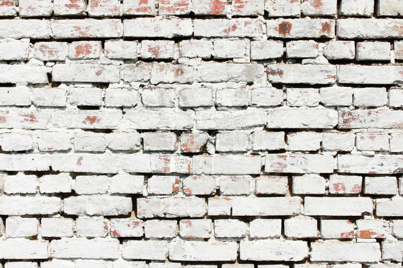 White Old brick wall background. Textured Background.Dirty Whitewashed Shabby Plaster. White Brick Wall Texture. Space for text. royalty free stock images