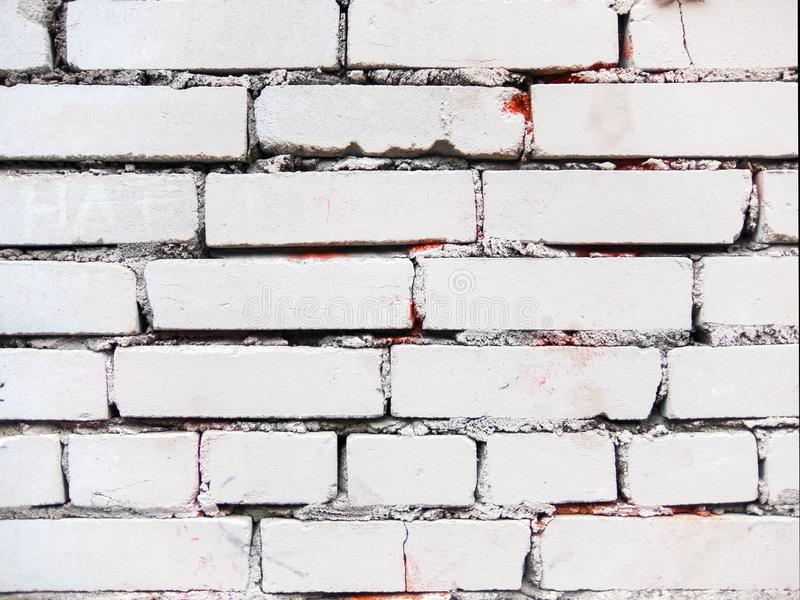 White old brick wall. Streaks red. royalty free stock photography