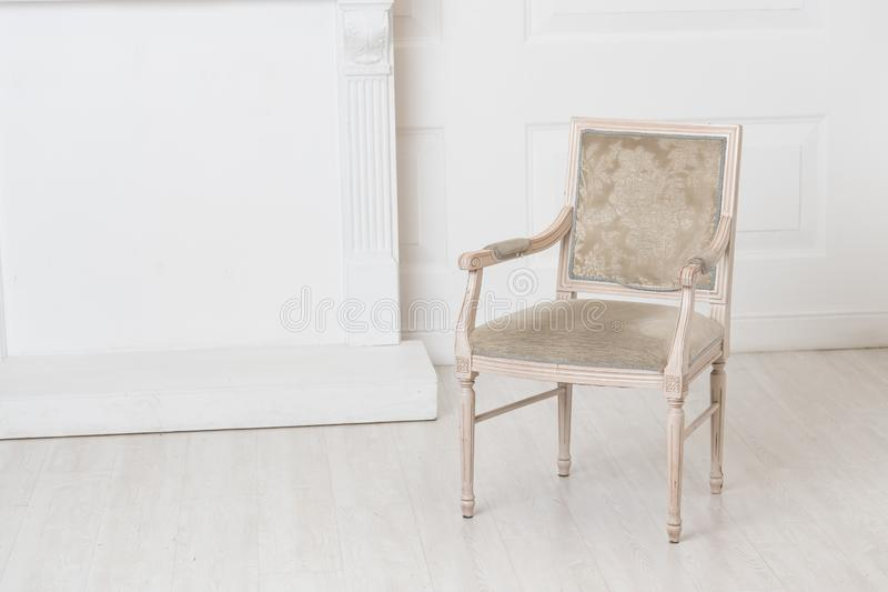 White old-fashioned retro style chair standing in an empty room royalty free stock image