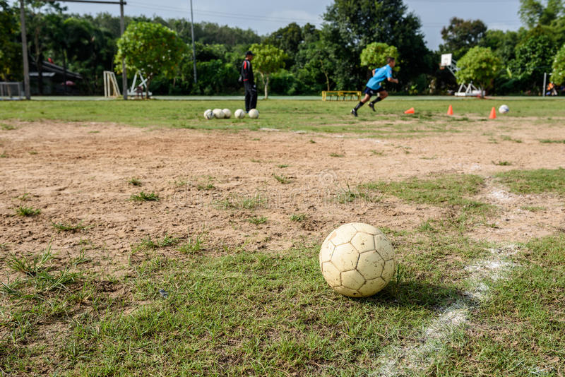 White old soccer ball. On soccer field,that boys are practicing soccer royalty free stock photography