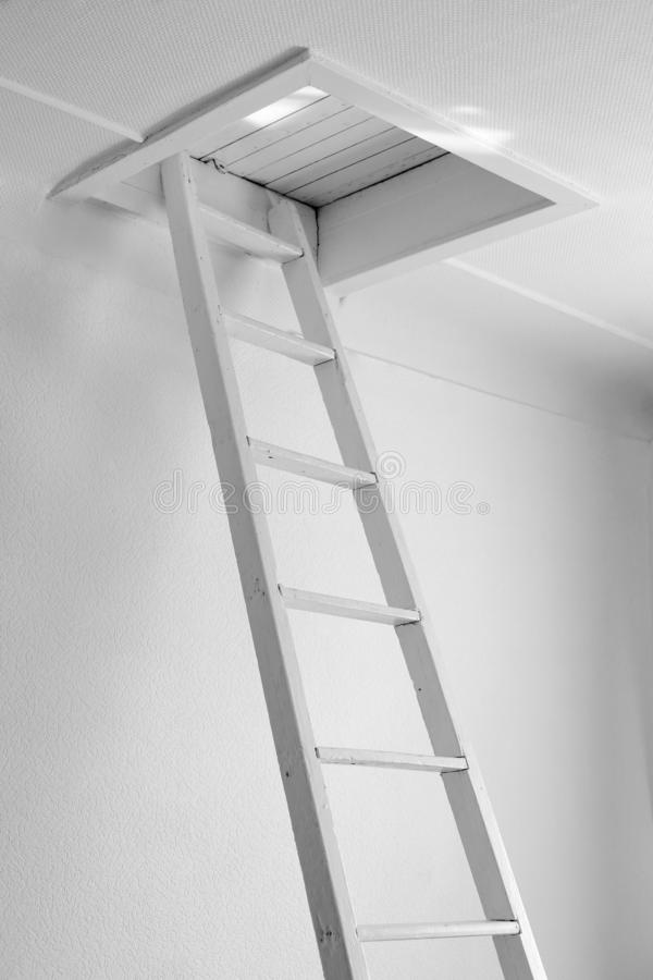 White old staircase to a closed wooden attic royalty free stock image