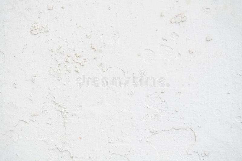 White Old Vintage Pain Peeling Wall Cracks Texture for background and design art work. Vintage Seamless Old Pain Peeling Wall Cracks Texture for background and stock photography