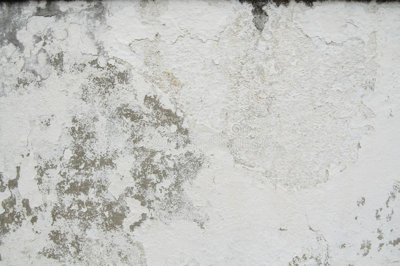 White Old Vintage Pain Peeling Wall Cracks Texture for background and design art work. Vintage Seamless Old Pain Peeling Wall Cracks Texture for background and stock photo