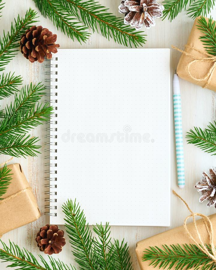 White open notepad, bullet journal for wish list and Christmas decoration on white wooden background, flat lay, copy space. Hand stock photos