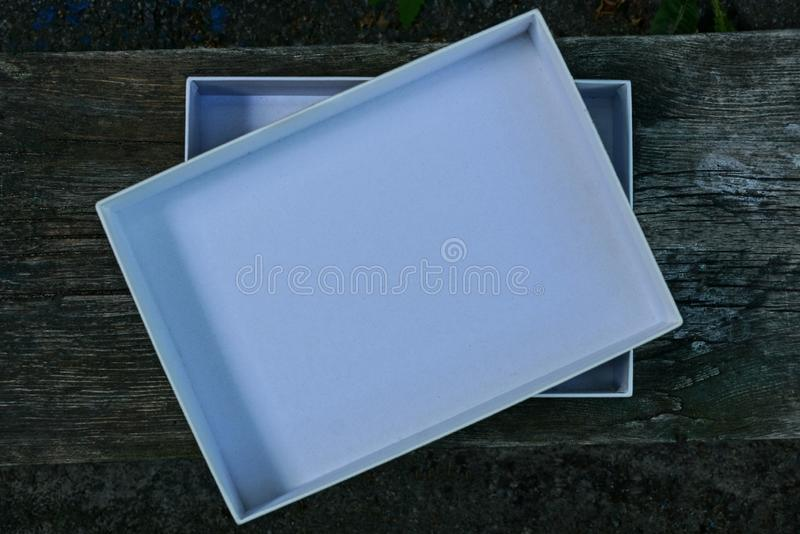 White open paper box on gray wooden table royalty free stock photos