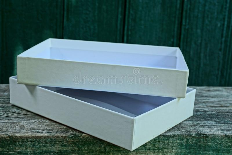 White open paper box on gray wooden table stock photo