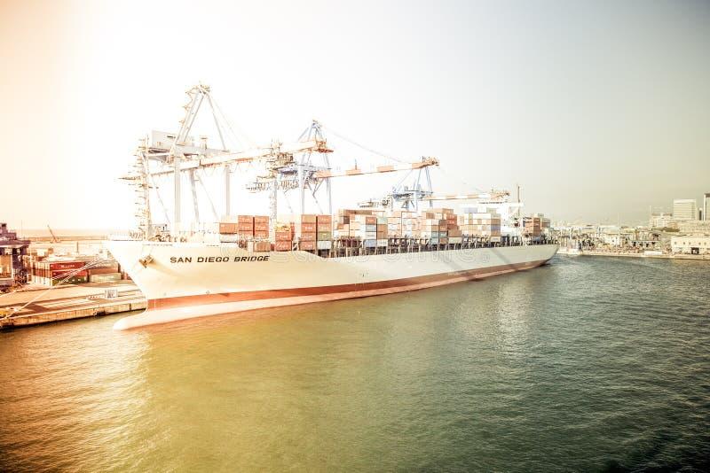 White and Orange Cargo Ship Docking during Daytime royalty free stock photo
