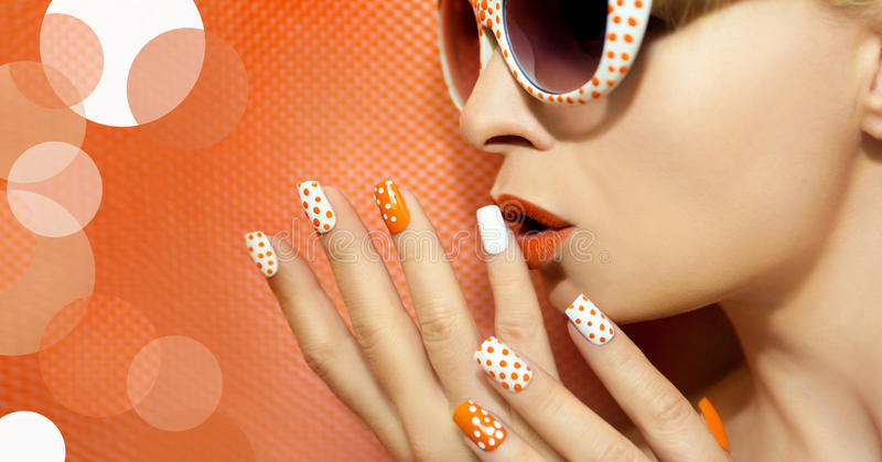 White orange manicure and makeup . stock photo