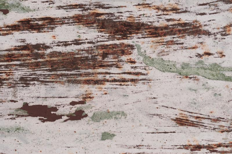 Painted scratched and cracks rusty grunde textured surface for background. White and orange painted scratched and cracks rusty grunde textured surface for stock photography
