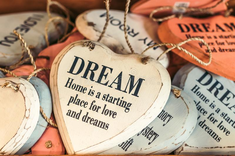 White and Orange Wooden Heart Dream Quote Decor Lot stock images