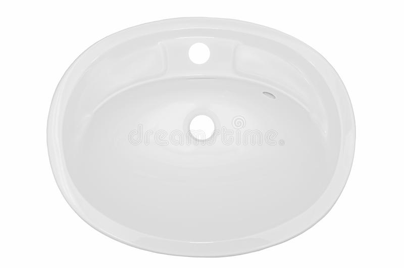 White oval washbasin in the bathroom of an artificial stone royalty free stock photo