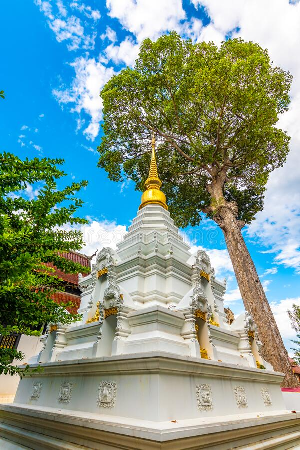 White pagoda near Wat Chedi Luang temple, Chiang Mai city, Thailand. Religion ancient building near main temple.  stock photos