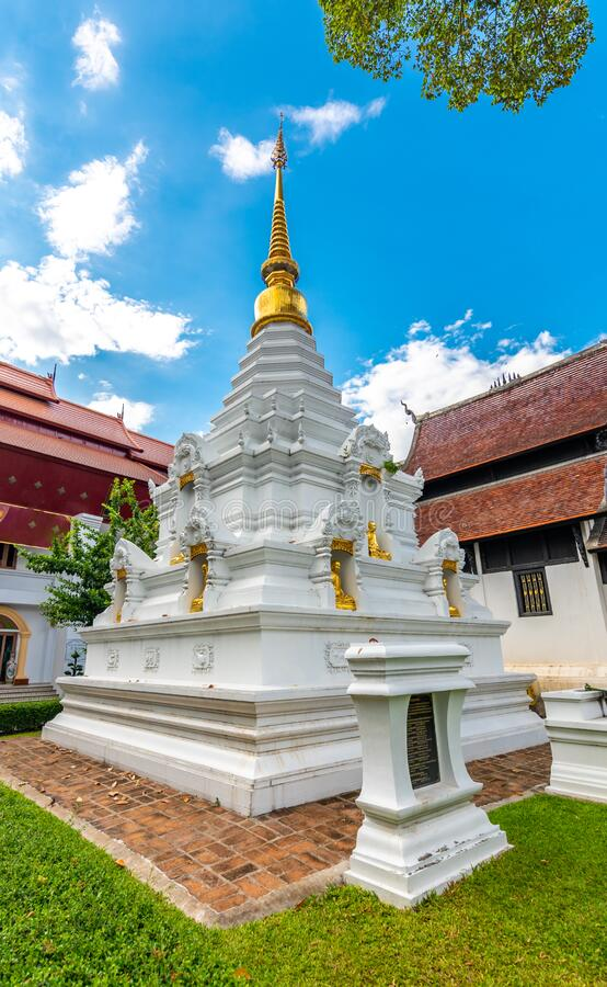 White pagoda near Wat Chedi Luang temple, Chiang Mai city, Thailand. Religion ancient building near main temple.  royalty free stock image