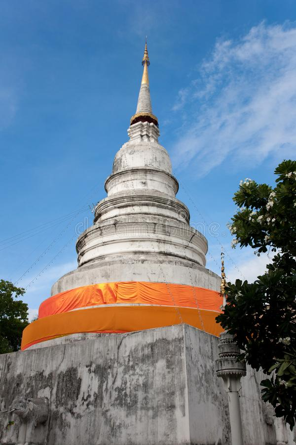 White pagoda with yellow robe stock photography