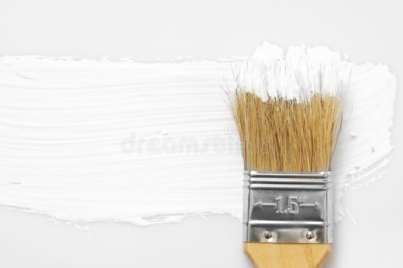 White paint stroke and brush. White paint brush stroke on white background. Top view point stock photo