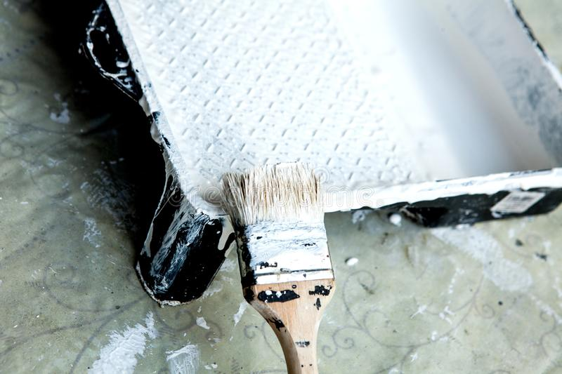 White paint, brush and tray, for painting white ceiling or trim.  royalty free stock photography