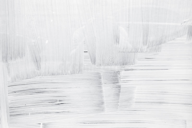 White paint layer on glass wall stock image