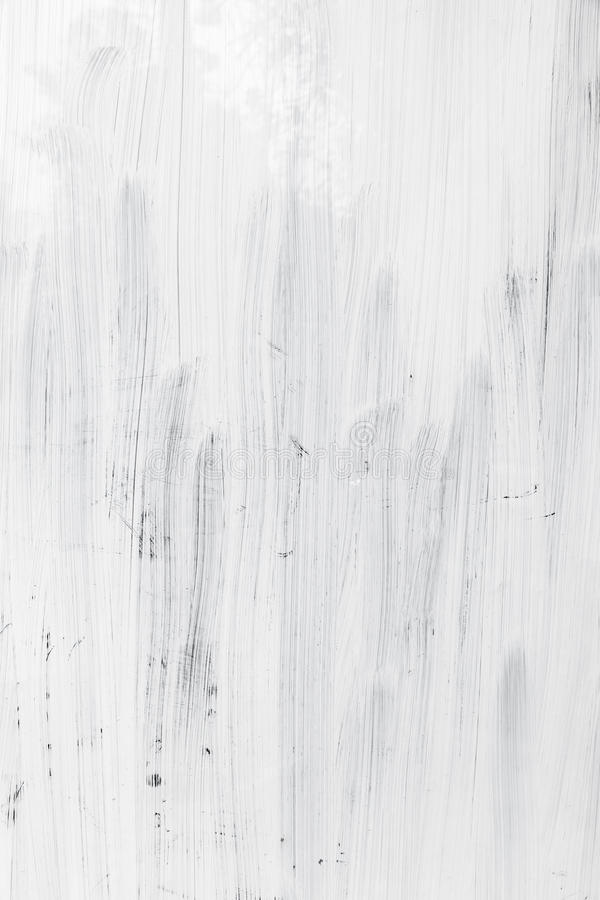 White paint layer over glass wall, vertical background royalty free stock image