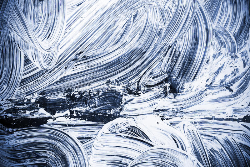 White paint over dark blue glass royalty free stock photo