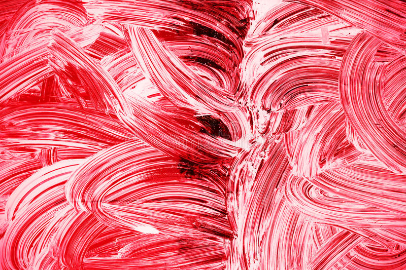 White paint pattern over dark red glass royalty free stock images