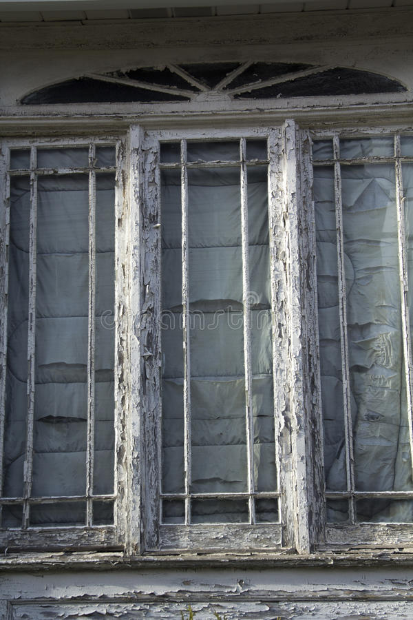 White Paint Peeling In Chips Off Window Frames. Stock Photo - Image ...