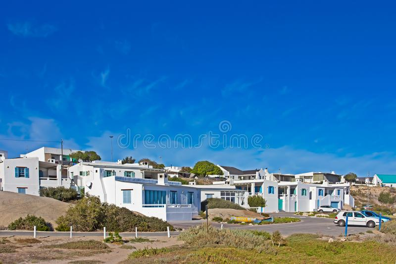 White painted housing units and blue sky royalty free stock image