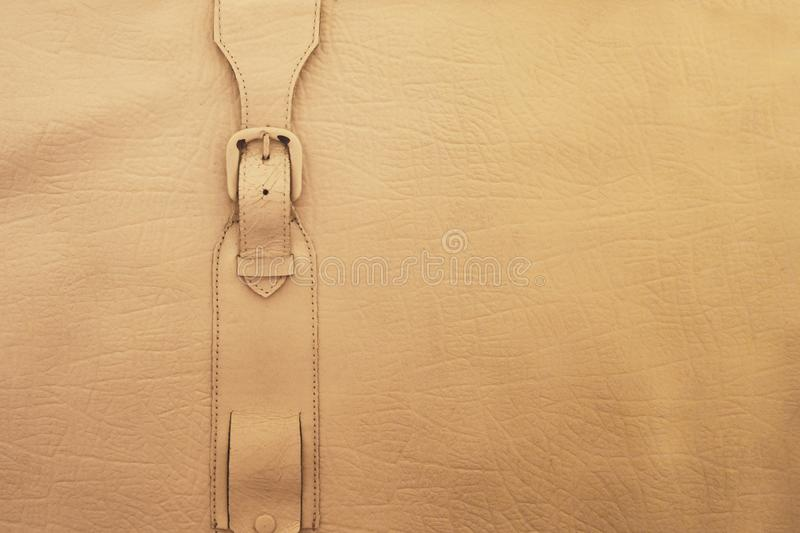 White painted leather surface with metal buckle strap. Macro of vintage rustic suitcase, shoes, apparel or accessories with copy royalty free stock photos