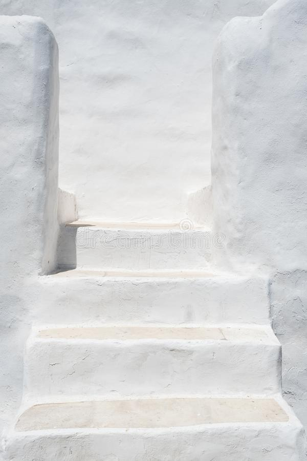 White painted stairs in a traditional Cycladic architecture style royalty free stock photos