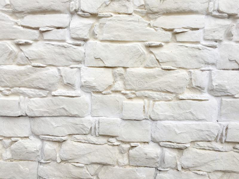 White painted stone wall texture as background. Cracked concrete vintage block stone wall background, old painted wall. Background stock images