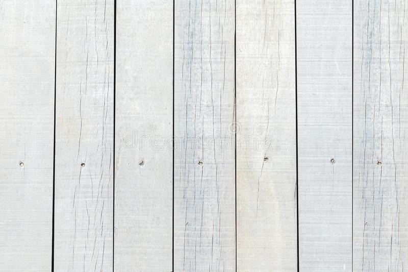 White painted vintage and old weathered wood wall background. Close up beautiful wooden plank texture in light natural background. royalty free stock image