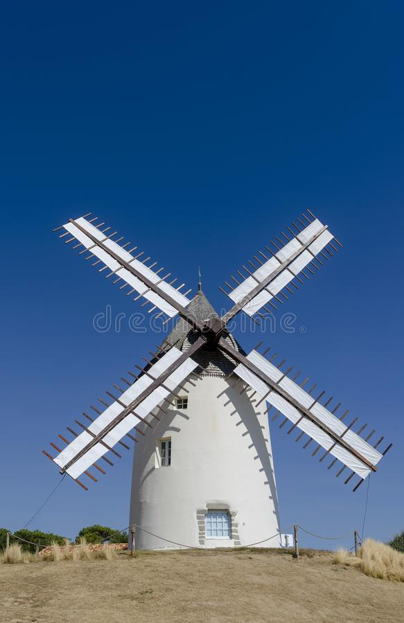 Free White Painted Windmill With Sails Against A Blue Sky Stock Photo - 138356110