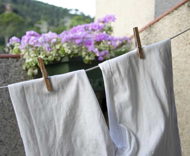 White pants stretched. Tongs that hold washed pants lying for drying stock photos
