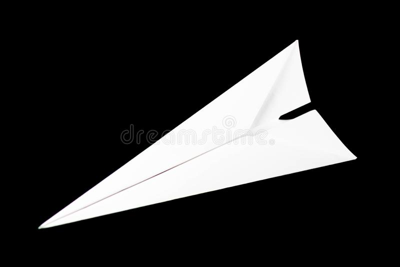 White paper airplane. Top view. Close up. Isolated on black background stock photos