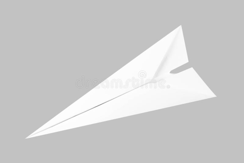 White paper airplane. Top view. Close up. Isolated on black background royalty free stock images