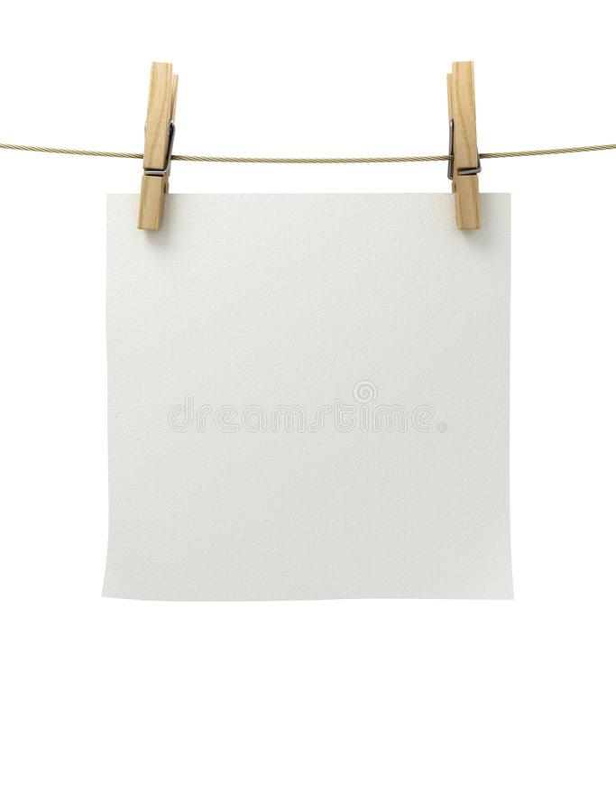 White paper attached to a rope clothespin. Close up stock illustration