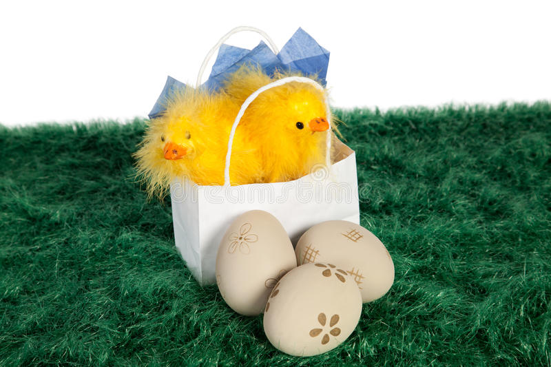 White paper bag with Easter baby chickens stock photos