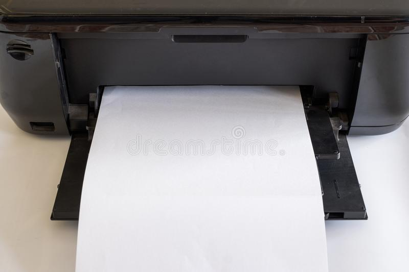 White paper in black printer toner and color. S royalty free stock photography