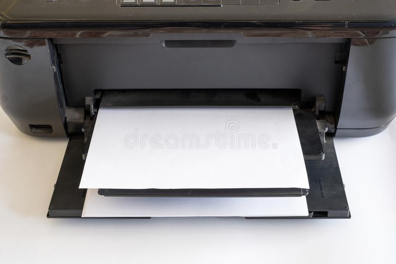 White paper in black printer toner and color. S royalty free stock images