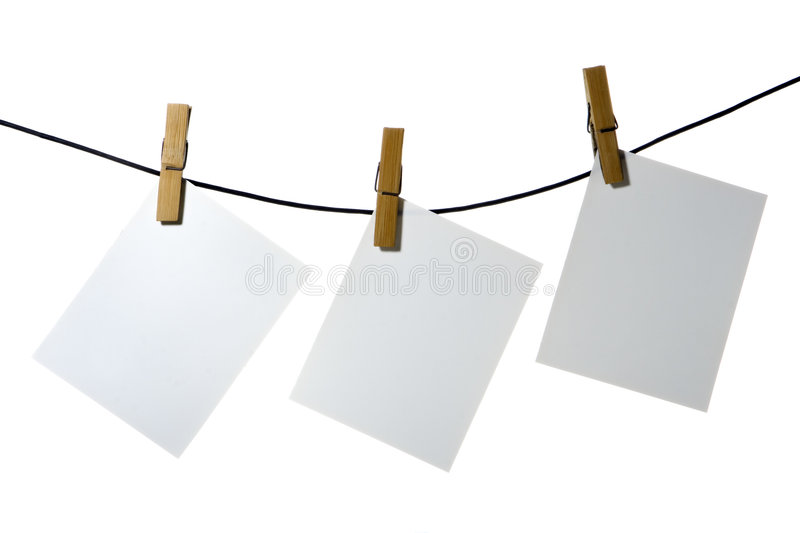 White paper clothes-peg rope stock photography